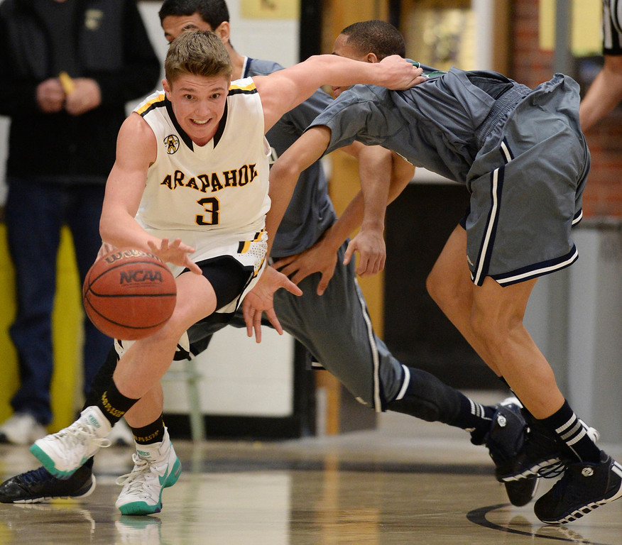 . CENTENNIAL, CO. JANUARY 18: Nick Farmen of Arapahoe High School (3) controls the ball against Overland High School defense in the 2nd half of the game at Arapahoe High School. Centennial Colorado. January 18. 2014. Arapahoe won 62-54.  (Photo by Hyoung Chang/The Denver Post)