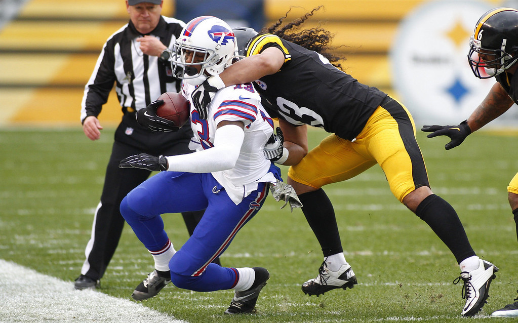 . Troy Polamalu #43 of the Pittsburgh Steelers tackles Steve Johnson #13 of the Buffalo Bills during the game on November 10, 2013 at Heinz Field in Pittsburgh, Pennsylvania.  (Photo by Justin K. Aller/Getty Images)