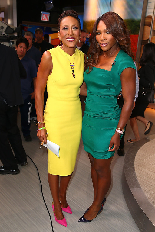""". 2013 US Open Champion Serena Williams of the United States poses for a photo with TV Personality Robin Roberts backstage of the \""""Good Morning America\"""" show on her New York City Trophy Tour on September 9, 2013 in New York City.  (Photo by Joe Scarnici/Getty Images)"""