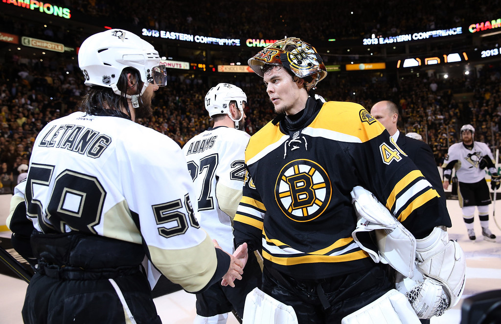 . BOSTON, MA - JUNE 07: Tuukka Rask #40 of the Boston Bruins shakes hands with Kris Letang #58 of the Pittsburgh Penguins after the Bruins defeated the Penguins 1-0 in Game Four of the Eastern Conference Final during the 2013 NHL Stanley Cup Playoffs at the TD Garden on June 7, 2013 in Boston, United States.  (Photo by Bruce Bennett/Getty Images)