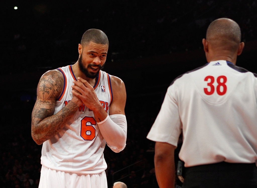 . Tyson Chandler #6 of the New York Knicks looks to referee Michael Smith #38 regarding a foul in the game against the Denver Nuggets at Madison Square Garden on December 9, 2012 in New York City.  (Photo by Bruce Bennett/Getty Images)