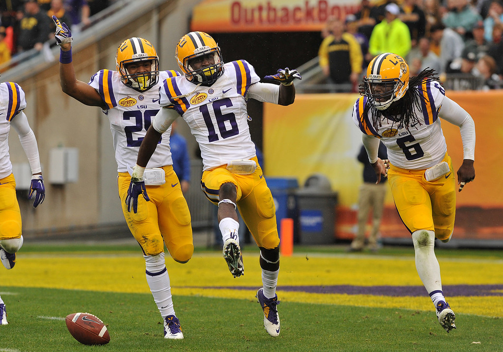 . Defensive back Tre\'Davious White #16 of the LSU Tigers celebrates with Craig Loston #6 after intercepting a first half pass against the Iowa Hawkeyes January 1, 2014  in the Outback Bowl at Raymond James Stadium in Tampa, Florida.  (Photo by Al Messerschmidt/Getty Images)