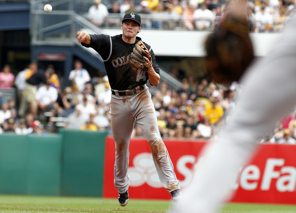 . Josh Rutledge #14 of the Colorado Rockies makes a throw to first in the fifth inning against the Pittsburgh Pirates during the game at PNC Park on July 20, 2014 in Pittsburgh, Pennsylvania.  (Photo by Justin K. Aller/Getty Images)