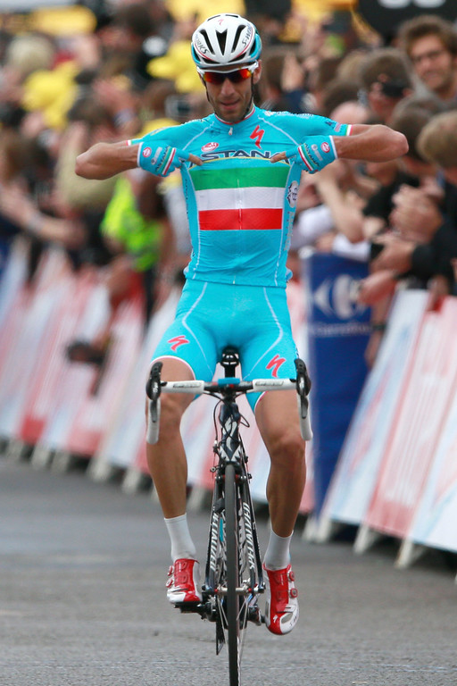 . Italy\'s Vincenzo Nibali crosses the finish line to win the second stage of the Tour de France cycling race over 201 kilometers (124.9 miles) with start in York and finish in Sheffield, England, Sunday, July 6, 2014. (AP Photo/Peter Dejong)
