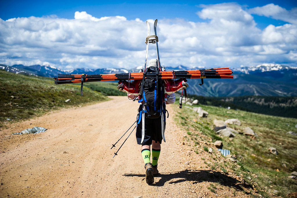 . Doug Briggs, of Breckenridge carries the ski gates that will be used to setup the course for the 49th running of the Epworth Cup, an unofficial ski race atop Corona Pass on Sunday, July 13, 2014 in Winter Park, CO.  The summer ski race, which was originally founded in 1966 is a memorial to a Winter Park patroller that died on Mt Epworth.  (Photo by Kent Nishimura/The Denver Post)