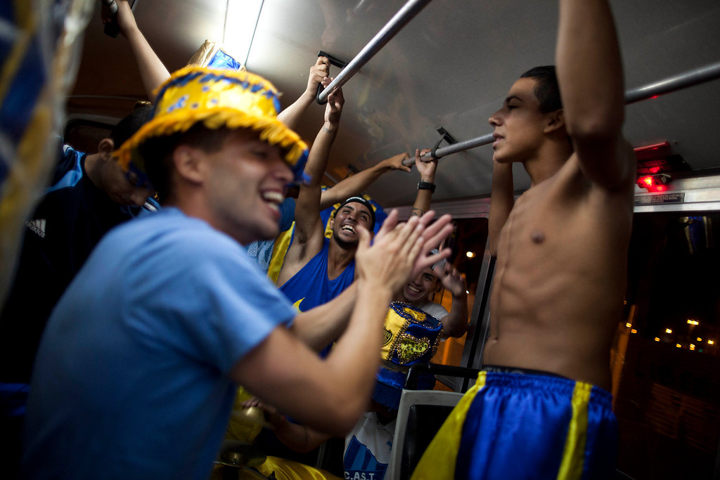 ". Members of the murga ""Los amantes de La Boca\"" have fun on a bus as they head to carnival celebrations in Buenos Aires, Argentina, Saturday, Feb. 2, 2013.  (AP Photo/Natacha Pisarenko)"