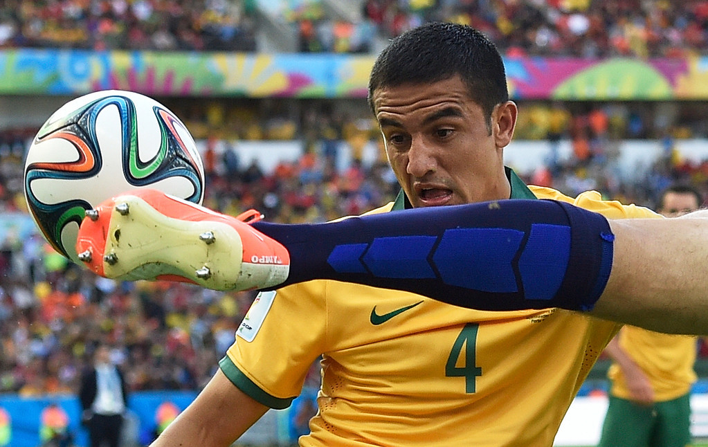 . Australia\'s Tim Cahill, left, watches as Netherlands\' Ron Vlaar clears the ball during the group B World Cup soccer match between Australia and the Netherlands at the Estadio Beira-Rio in Porto Alegre, Brazil, Wednesday, June 18, 2014.  (AP Photo/Martin Meissner)