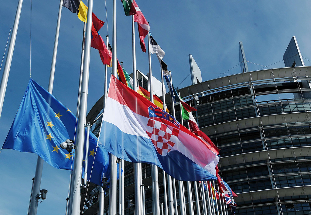 . The Croatian flag flutters after being raised during a ceremony for Croatia\'s accession to the European Union on July 1, 201 at the European Parliament in Strasbourg, eastern France. Croatia woke up on Monday as the newest EU state after a night of celebrations dampened by fears that membership to the bloc could add to the recession-hit country\'s economic burden.  FREDERICK FLORIN/AFP/Getty Images