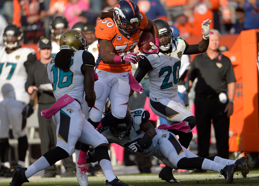 . Denver Broncos strong safety David Bruton (30) makes a 35-yard run after a fake punt by the Broncos in the third quarter.   (Photo by Joe Amon/The Denver Post)