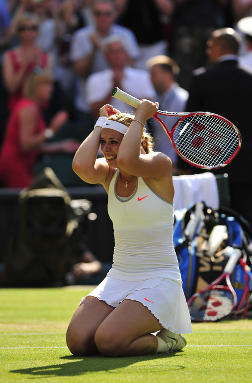 . Germany\'s Sabine Lisicki celebrates beating Poland\'s Agnieszka Radwanska during their women\'s singles semi-final match against on day ten of the 2013 Wimbledon Championships tennis tournament at the All England Club in Wimbledon, southwest London, on July 4, 2013. Lisicki won 6-4, 2-6, 9-7.  GLYN KIRK/AFP/Getty Images
