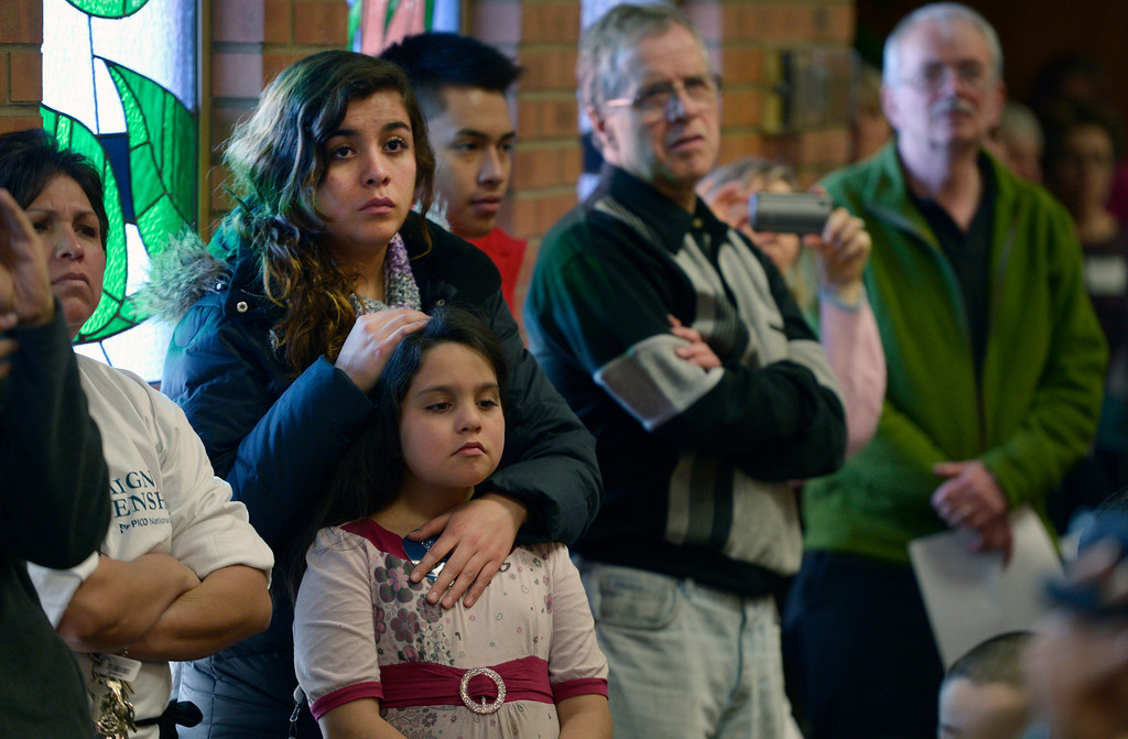 . AURORA, CO- FEBRUARY 9:  Carolina Calderon, 18, and her sister Teresa, 8, listen during the meeting that was filled to capacity in St. Therese Catholic Church.  TOGETHER COLORADO held a public meeting  to talk about the United States immigration policies at St. Therese Catholic Church, 1243 Kingston Street in Aurora, Co  on February 9th, 2013.   Colorado State Senator Michael Bennet, and Colorado Representatives Mike Coffman and Jared Polis attended and spoke at the meeting.  The organization wanted to tell the state\'s representatives why they want a road map to citizenship for 11 million aspiring Americans.  More than 800 faith and community leaders packed the small church in Aurora. (Photo By Helen H. Richardson/ The Denver Post)