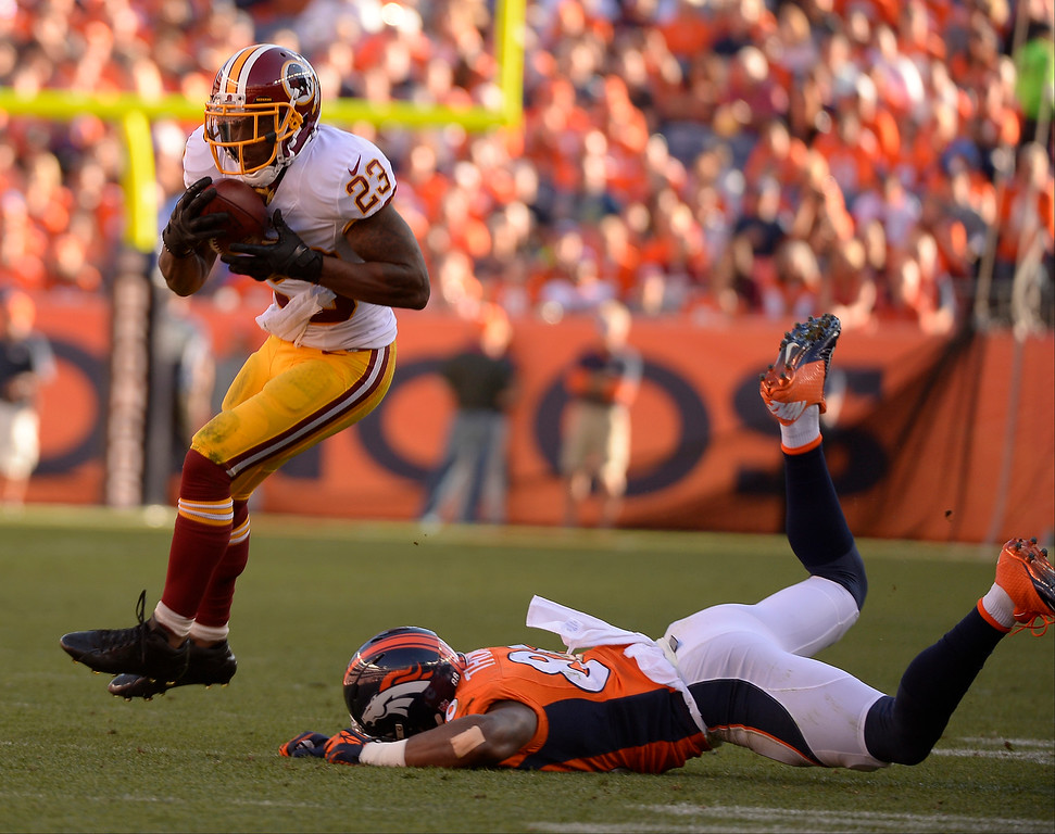 . Washington Redskins cornerback DeAngelo Hall (23) intercepts a Denver Broncos quarterback Peyton Manning (18) pass and runs it in for a touchdown in the third quarter.  (Photo by John Leyba/The Denver Post)