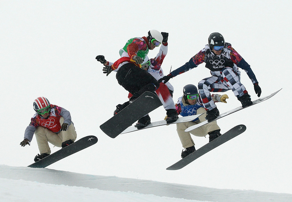 . United States\' Trevor Jacob, from left, Spain\'s Lucas Eguibar, Canada\'s Kevin Hill, United States\' Alex Deibold, and Russia\'s Nikolay Olyunin compete during the men\'s snowboard cross semifinal at the Rosa Khutor Extreme Park, at the 2014 Winter Olympics, Tuesday, Feb. 18, 2014, in Krasnaya Polyana, Russia. (AP Photo/Jae C. Hong)