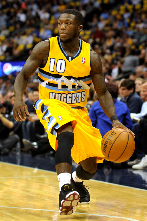 . DENVER, CO. - NOVEMBER 1:  Denver guard Nate Robinson scanned the court in the first half. The Denver Nuggets hosted the Portland Trail Blazers Friday night, November 1, 2013 at the Pepsi Center.  Photo By Karl Gehring/The Denver Post