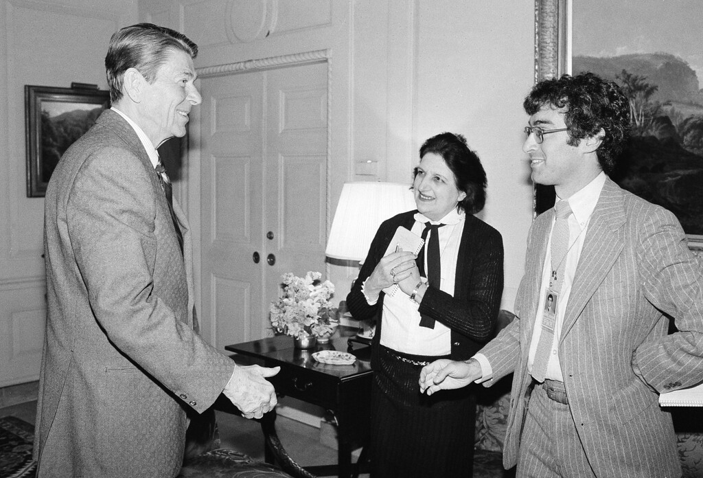 . President Ronald Reagan greets Associated Press White House reporter Jim Gerstenzang, at right, and reporter Helen Thomas, United Press International, center, before his first interview April 13, 1981 since being shot on March 30, 1981 in Washington.    This meeting took place in the Treaty Room of the White House.  (AP Photo/Barry Thumma)