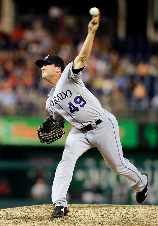 . Colorado Rockies relief pitcher Rex Brothers (49) throws during the eighth inning of a baseball game against the Washington Nationals at Nationals Park, Thursday, June 20, 2013, in Washington. The Nationals won 5-1. (AP Photo/Alex Brandon)