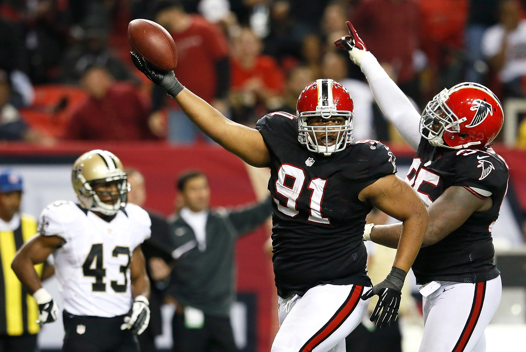 . ATLANTA, GA - NOVEMBER 29:  Corey Peters #91 and Jonathan Babineaux #95 of the Atlanta Falcons celebrates after Peters intercepted a pass by Drew Brees #9 of the New Orleans Saints that was overturned on a Falcons offsides penalty at Georgia Dome on November 29, 2012 in Atlanta, Georgia.  (Photo by Kevin C. Cox/Getty Images)
