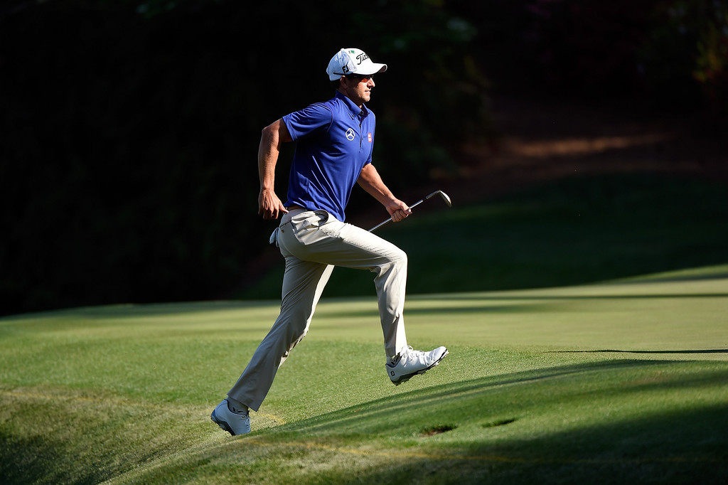 . Adam Scott of Australia runs to the green after hitting his third shot on the 13th hole during the third round of the 2014 Masters Tournament at Augusta National Golf Club on April 12, 2014 in Augusta, Georgia.  (Photo by Harry How/Getty Images)