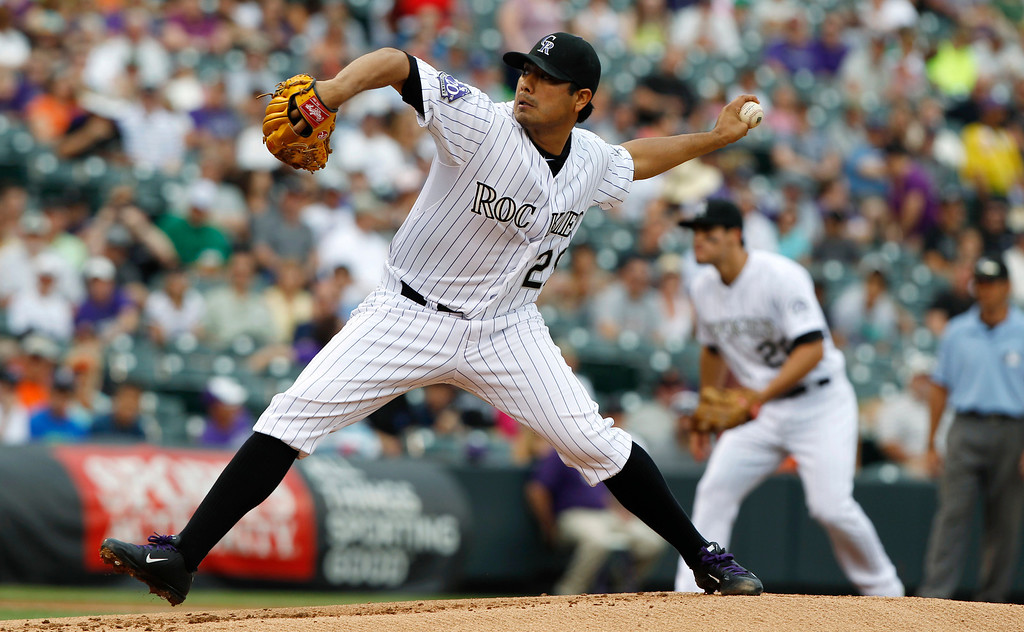 . Colorado Rockies starting pitcher Jorge De La Rosa works against the San Francisco Giants in the first inning of a baseball game in Denver on Saturday, June 29, 2013. (AP Photo/David Zalubowski)