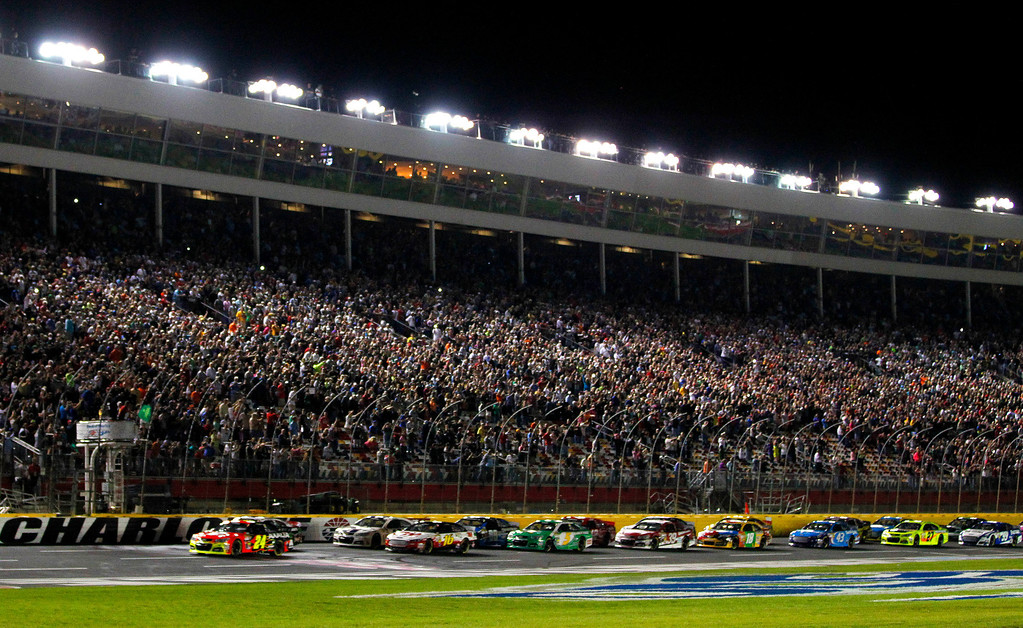 . Jeff Gordon (24) takes the green flag to start the NASCAR Sprint Cup Series auto race at Charlotte Motor Speedway in Concord, N.C., Saturday, Oct. 12, 2013. (AP Photo/Terry Renna)