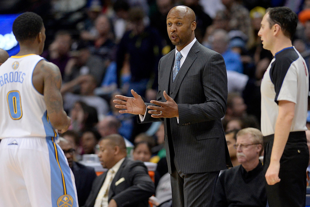 . Denver Nuggets head coach Brian Shaw speaks with Aaron Brooks during the second quarter. (Photo by AAron Ontiveroz/The Denver Post)