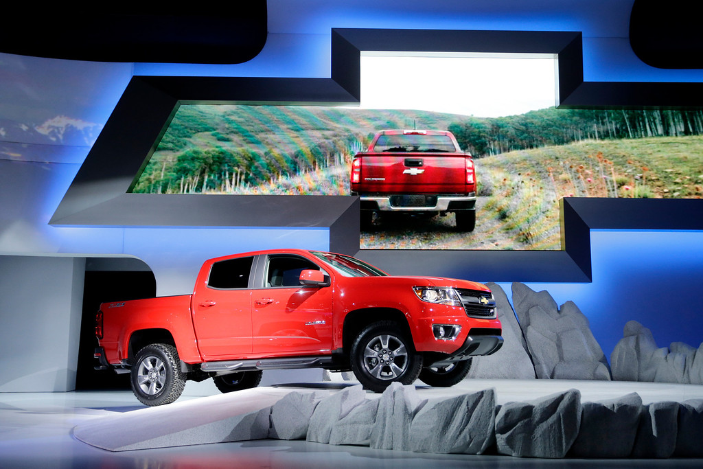 . The new 2015 Chevrolet Colorado is introduced at the Chevrolet booth at the Los Angeles Auto Show on Wednesday, Nov. 20, 2013, in Los Angeles. (AP Photo/Jae C. Hong)