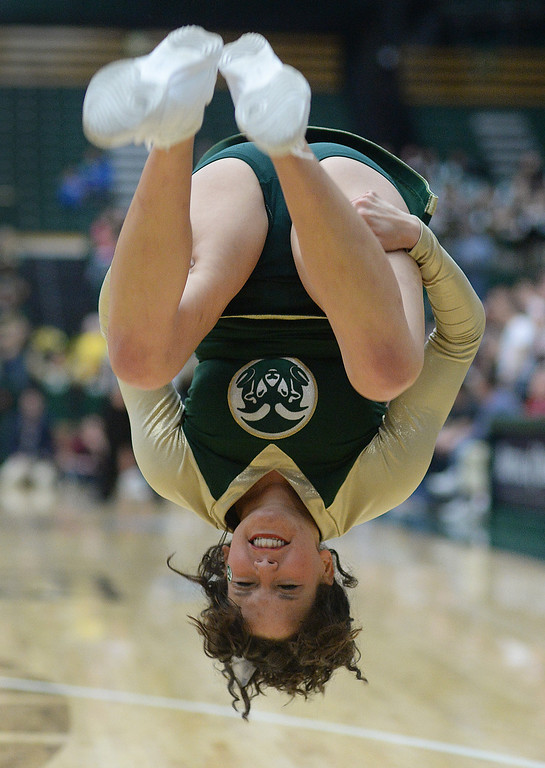 . FORT COLLINS, CO. - JANUARY 18:  A Colorado State cheerleader did a flip following a successful free-throw in the first half. The Colorado State men\'s basketball team hosted Air Force at Moby Arena in Fort Collins Saturday night, January 18, 2014. Photo By Karl Gehring/The Denver Post