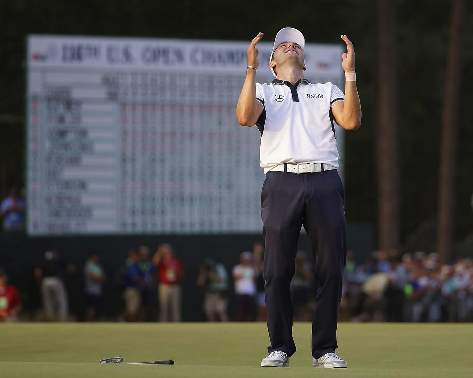 . Martin Kaymer, of Germany celebrates after winning the U.S. Open golf tournament in Pinehurst, N.C., Sunday, June 15, 2014.  (AP Photo/David Goldman)