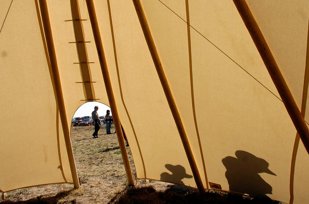 . Two people are seen walking near a teepee setup as part of the dedication of the Sand Creek Massacre National Historic Site on Saturday, April 28, 2007, 15-miles west of Eads, Colorado.  RJ Sangosti/ The Denver Post