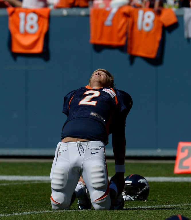 . Denver Broncos QB, Zac Dysert, stretches before practice and scrimmage at Sports Authority Field at Mile High Saturday afternoon, August 02, 2014. (Photo By Andy Cross / The Denver Post)