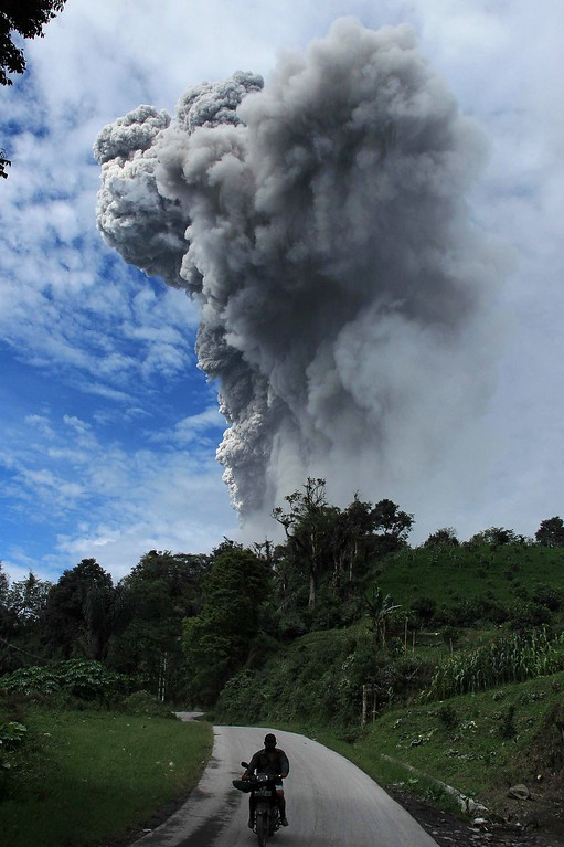 . This picture taken on November 24, 3013 shows Sinabung volcano spewing volcanic ash in Karo.  AFP PHOTO / KHARISMA TARIGAN/AFP/Getty Images