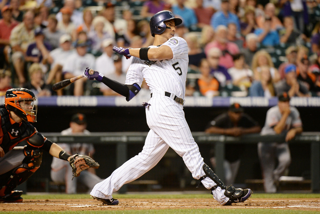 . DENVER, CO. - June 28: Carlos Gonzalez of Colorado Rockies (5) doubles and scored 1RBI from Baryy Zito of  San Francisco Giants pitcher (75) in the 1st inning of the game at Coors Field. Denver, Colorado. June 28, 2013. (Photo By Hyoung Chang/The Denver Post)