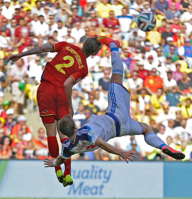 . Russia\'s Alexander Kokorin performs a bicycle kick to clear the ball ahead of Belgium\'s Toby Alderweireld (2) during the group H World Cup soccer match between Belgium and Russia at the Maracana Stadium in Rio de Janeiro, Brazil, Sunday, June 22, 2014. (AP Photo/Natacha Pisarenko)