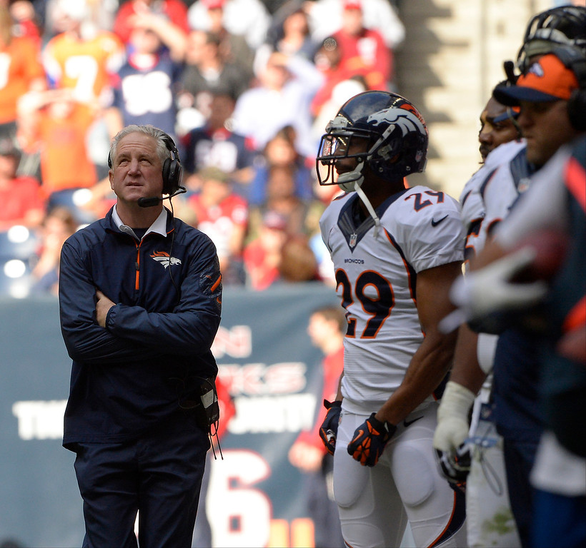 . Head coach John Fox of the Denver Broncos watching the screen in the second half vs the Houston Texans at Reliant Stadium December 22, 2013 Houston, Texas. (Photo By Joe Amon/The Denver Post)
