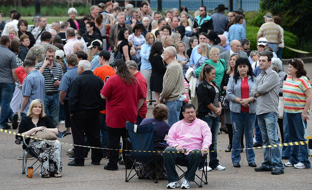 . Jeff Long, of Carton Ga., pink shirt, waits with the crowd to enter the Grand Ole Opry House for the funeral of country music star George Jones on Thursday, May 2, 2013, in Nashville, Tenn. (AP Photo/Mark Zaleski)