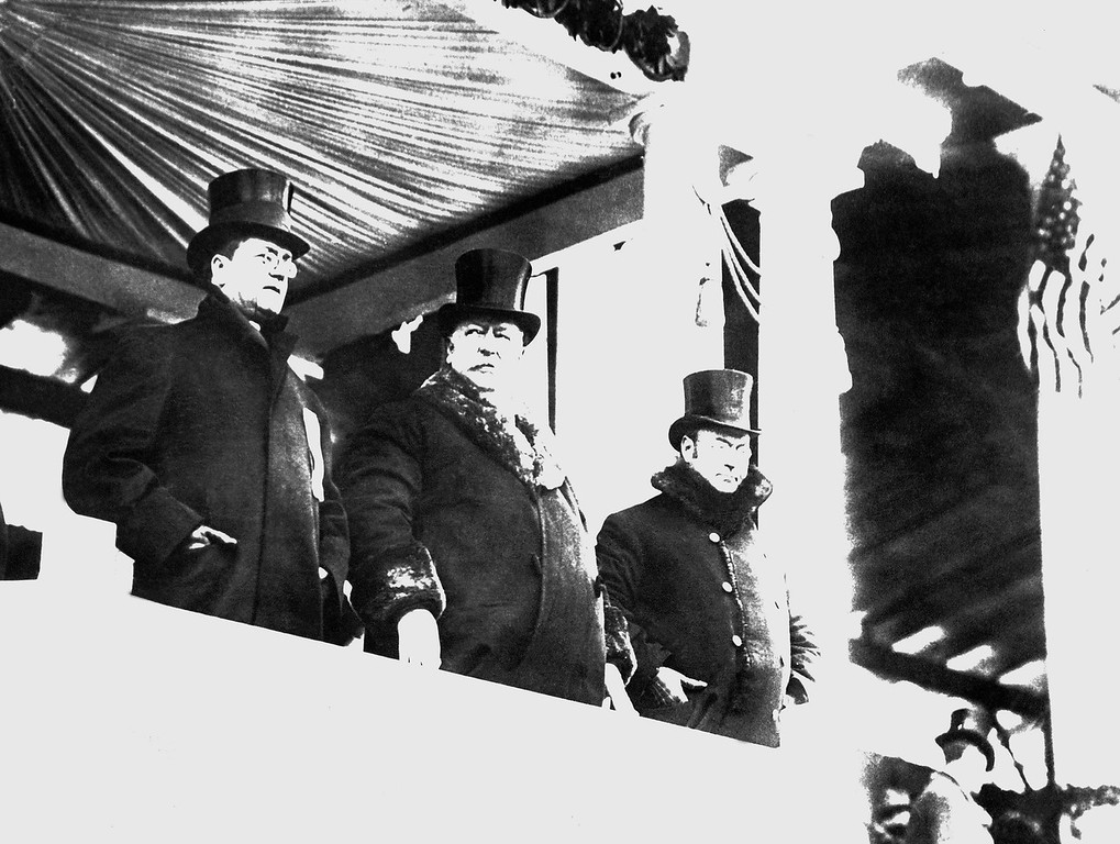 . William Howard Taft, center, wore a big fur-lined overcoat as he watched the parade after his inauguration as president, on March 4, 1909 in Washington. At right is James S. Sherman, vice president of the United States, and at left, Edward Hallwagon, chief of the Inaugural Committee. A whirling blizzard, featured by flashes of lighting, as well as rain, snow and a cutting wind, made it one of the roughest of all inauguration days. (AP Photo)