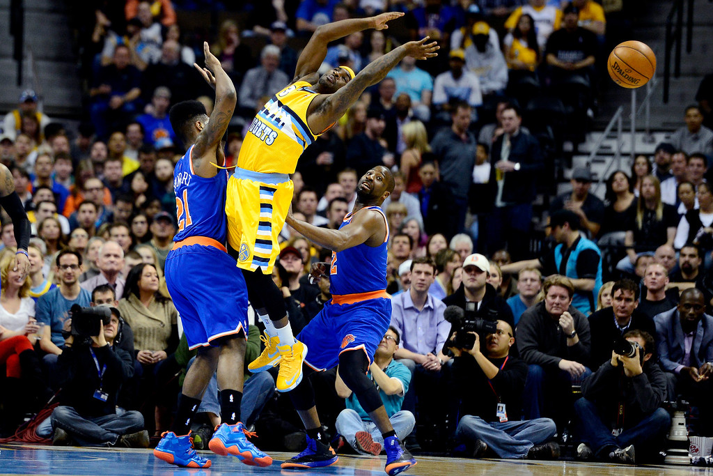 . DENVER, CO - MARCH 13: Iman Shumpert (21) of the New York Knicks and Raymond Felton defend Ty Lawson (3) of the Denver Nuggets during the first half of action. The Denver Nuggets play the New York Knicks at the Pepsi Center. (Photo by AAron Ontiveroz/The Denver Post)