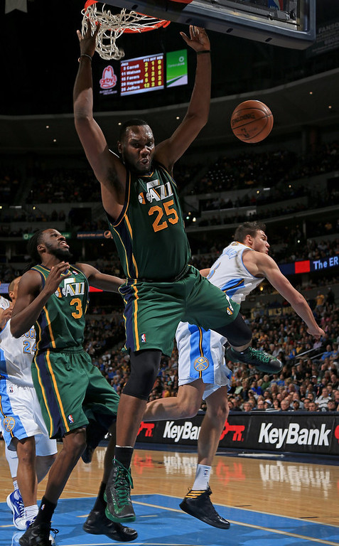. Al Jefferson #25 of the Utah Jazz looses control of the ball against the defense of Danilo Gallinari #8 of the Denver Nuggets at the Pepsi Center on January 5, 2013 in Denver, Colorado. The Nuggets defeated the Jazz 110-91. (Photo by Doug Pensinger/Getty Images)