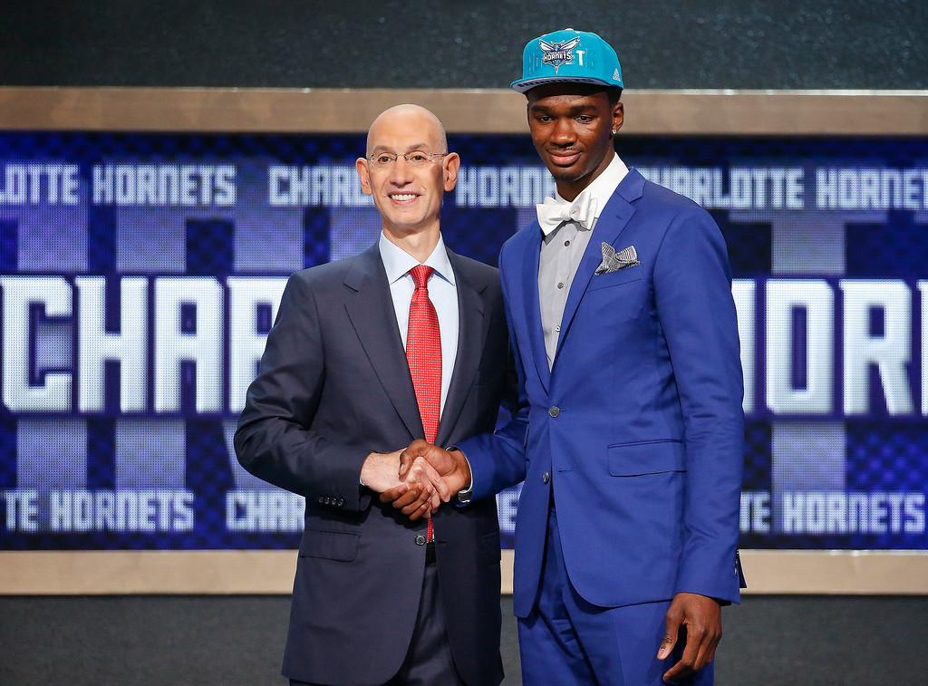 . Indiana\'s Noah Vonleh, right, poses for a photo with NBA Commissioner Adam Silver after being selected ninth overall by the Charlotte Hornets during the 2014 NBA draft, Thursday, June 26, 2014, in New York. (AP Photo/Jason DeCrow)