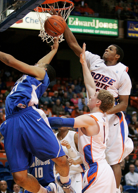 . Boise State\'s Derrick Marks (2) blocks a shot by Air Force\'s DeLovell Earls (21) during the second half of an NCAA college basketball game, Wednesday, Feb. 20, 2013, in Boise, Idaho. Boise State won 77-65. (AP Photo/Matt Cilley)