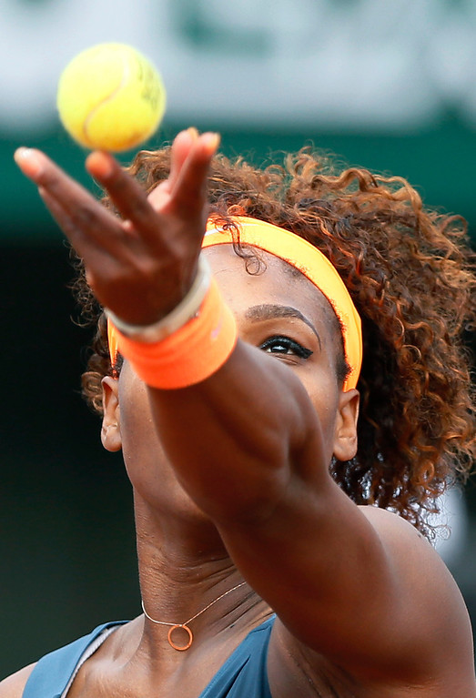 . USA\'s Serena Williams serves to Russia\'s Maria Sharapova during the 2013 French tennis Open final at the Roland Garros stadium in Paris on June 8, 2013. AFP PHOTO / PATRICK KOVARIK/AFP/Getty Images