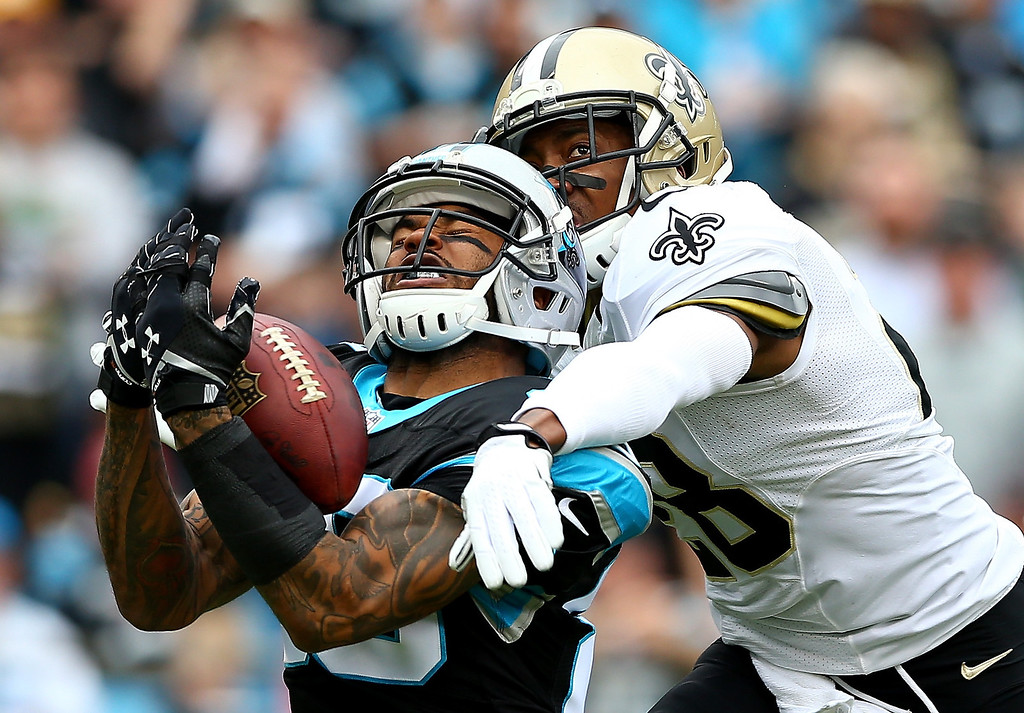. Steve Smith #89 of the Carolina Panthers makes a catch as  Keenan Lewis #28 of the New Orleans Saints tries to knock the ball loose during their game at Bank of America Stadium on December 22, 2013 in Charlotte, North Carolina.  (Photo by Streeter Lecka/Getty Images) ***