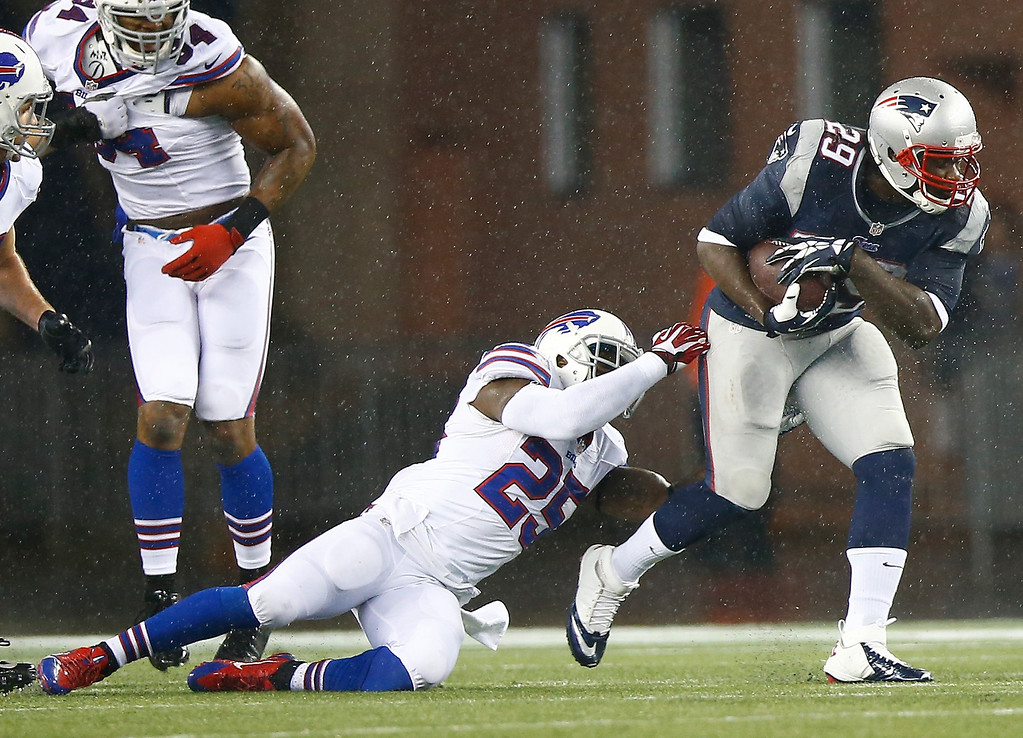 . LeGarette Blount #29 of the New England Patriots runs with the ball past Da\'Norris Searcy #25 of the Buffalo Bills in the first half during the game at Gillette Stadium on December 29, 2013 in Foxboro, Massachusetts.  (Photo by Jared Wickerham/Getty Images)