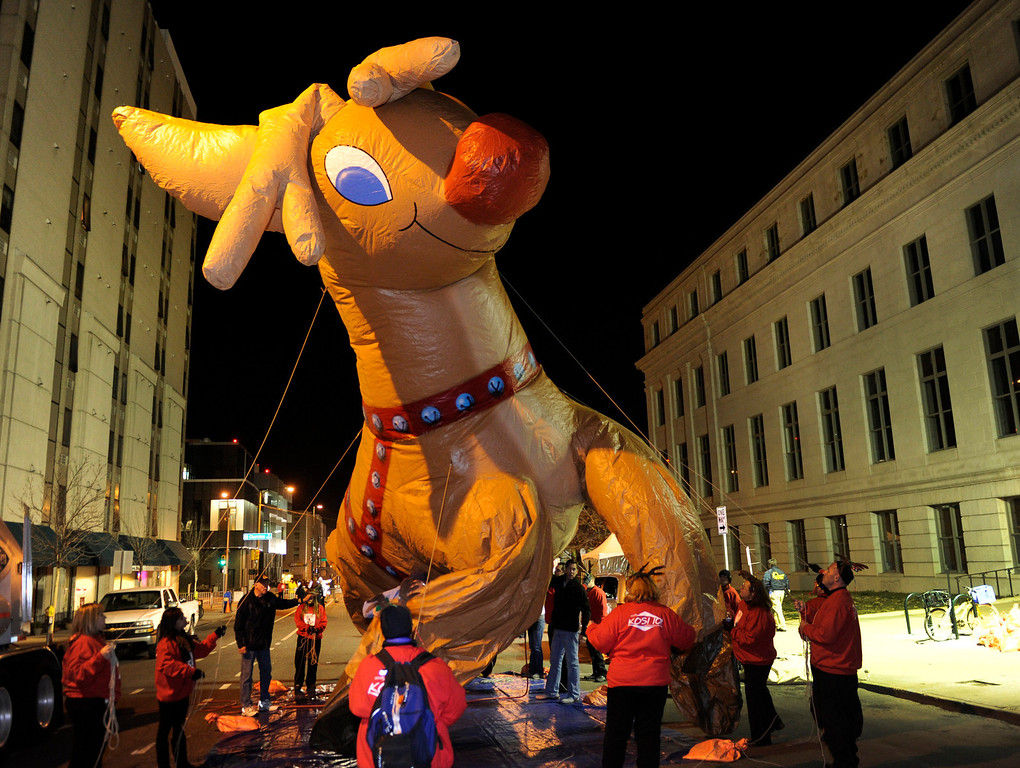 . The Rudolph balloon took shape as it was filled with helium. The annual Parade of Lights filed past the illuminated City and County building in downtown Denver Friday night, November 30. 2012. The parade with 11 floats, 7 bands, 5 giant balloons and more lights than anyone could count, had enough holiday spirit for everyone. Karl Gehring/ The Denver Post