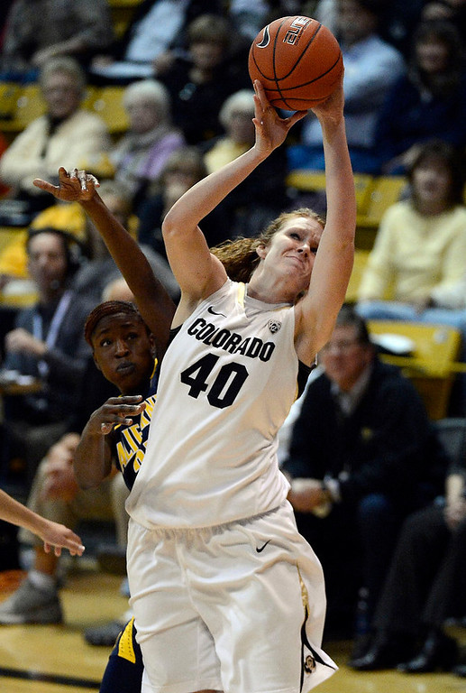 . Colorado Buffaloes center Rachel Hargis (40) gets fouled by California Golden Bears forward Gennifer Brandon (25) during the second half Sunday, January 6, 2013 at Coors Events Center. John Leyba, The Denver Post