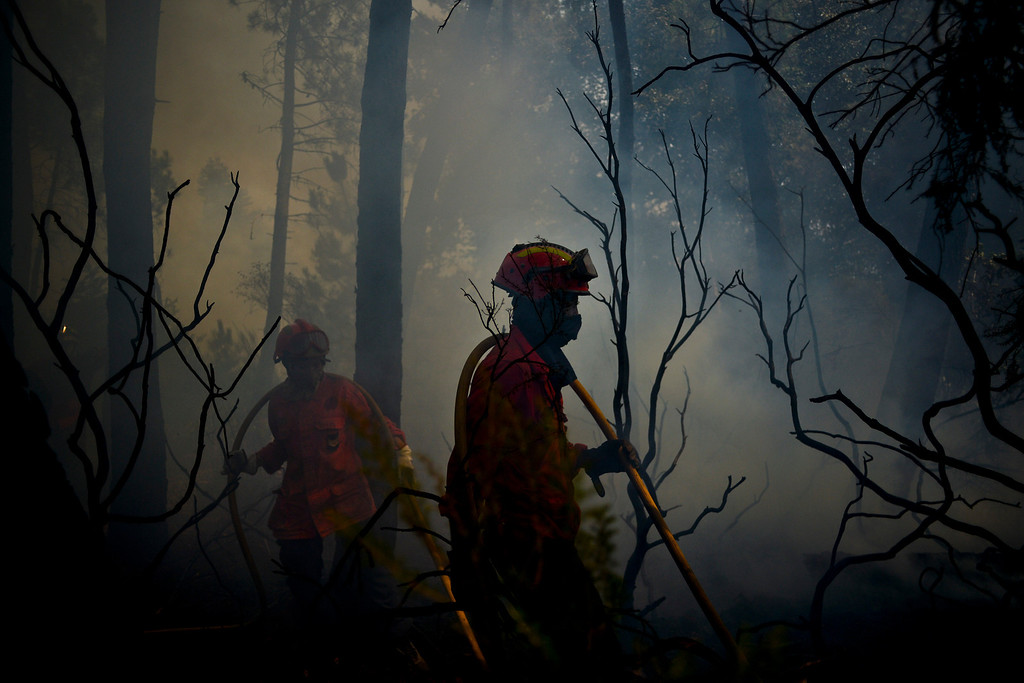 . Firefighter combat a wildfire around Caramulo, central Portugal, on August 30, 2013.  AFP PHOTO / PATRICIA DE MELO  MOREIRA/AFP/Getty Images