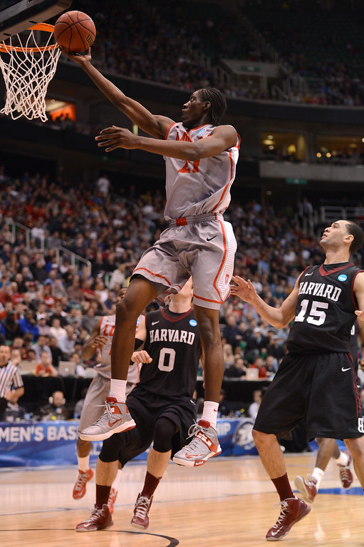 . SALT LAKE CITY, UT - MARCH 21:  Tony Snell #21 of the New Mexico Lobos lays the ball up in front of Christian Webster #15 of the Harvard Crimson in the first half during the second round of the 2013 NCAA Men\'s Basketball Tournament at EnergySolutions Arena on March 21, 2013 in Salt Lake City, Utah.  (Photo by Harry How/Getty Images)