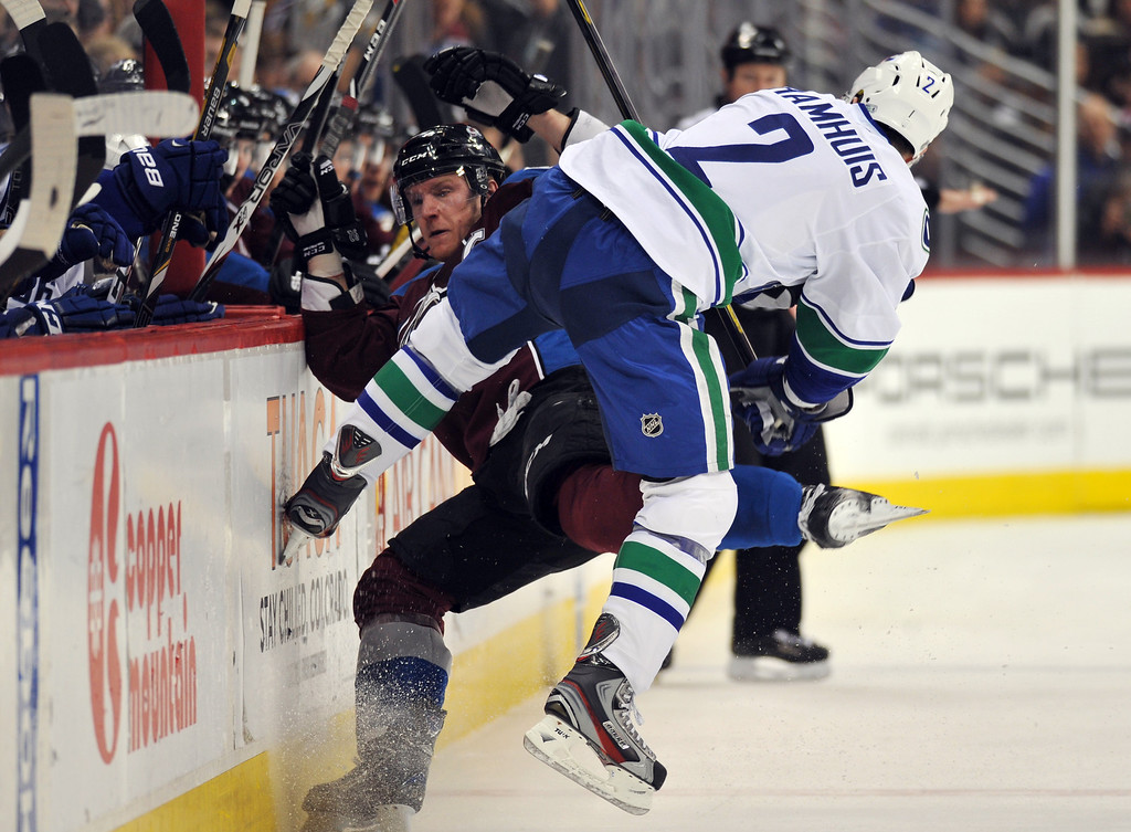 . DENVER, CO. - APRIL 13 : Dan Hamhuis of Vancouver Canucks (2) checks Gabriel Ladeskog (92) of Colorado Avalanche during the 1st period of the game at Pepsi Center. Denver, Colorado. April 13, 2013. (Photo By Hyoung Chang/The Denver Post)