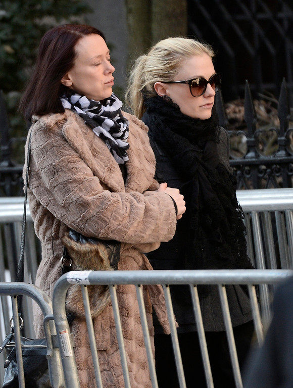 . Canadian actress Anna Paquin (R) arrives for the Funeral Mass for US Actor Phillip Seymour Hoffman at St Ignatius Church in New York, New York, USA 07 February 2014. Hoffman, 46, died 02 February from a suspected drug overdose.  EPA/ANDREW GOMBERT