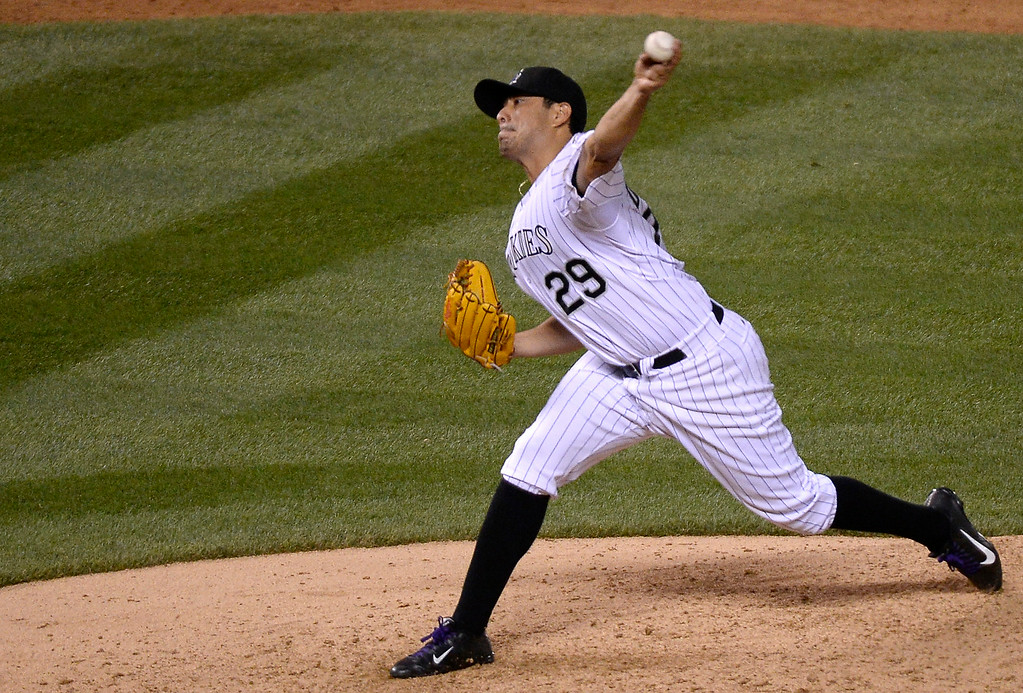. DENVER, CO - JUNE 24: Colorado Rockies starting pitcher Jorge De La Rosa (29) delivers a pitch during the sixth inning against the St. Louis Cardinals June 24, 2014 at Coors Field. (Photo by John Leyba/The Denver Post)